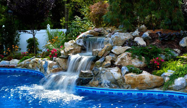 Landscape waterfall flowing into a pool